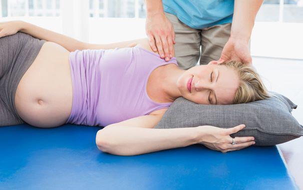 Как облегчить боль во время беременности